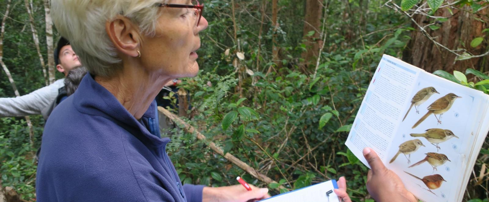 A senior volunteering abroad helps to count bird species during a census at our Conservation Project in Madagascar, Africa.